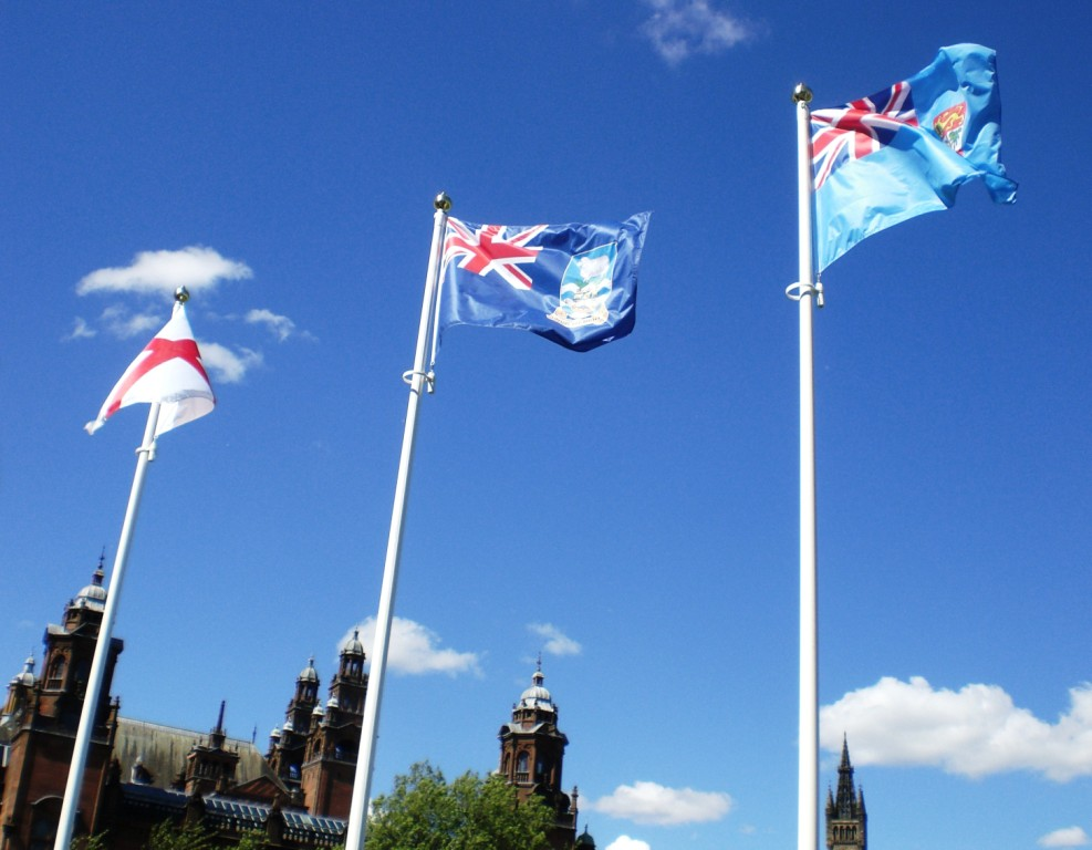 The Cross of St George, The Flag of the Falkland Islands and the Flag of Fiji in the grounds of Kelvingrove Museum, host of the Bowling, 6-7-14. Photo copyright Alistair McConnachie.